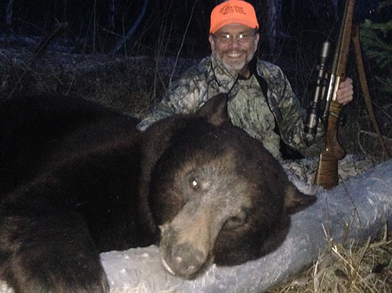 Bill L.'s 400 lb Wyoming chocolate bear taken with his Kilimanjaro 7x57 Walkabout rifle.