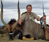 Kilimanjaro Custom Rifles Founder Erik Eike and Trophy of African Nyala